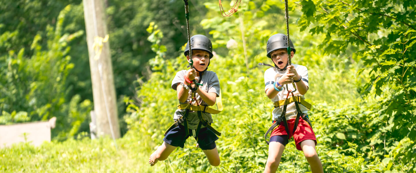 Kids on a zipline at day camp